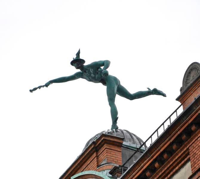 Bronze Statue Of Mercury On Old Pharmacy Building In Copenhagen